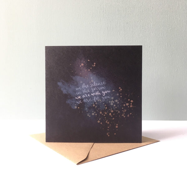 """A deep blue greetings card with an abstract pattern. The text reads: """"In the silence, in the sorrow, we are with you, we are for you."""""""